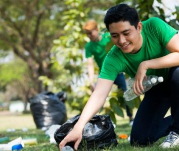 Hispanic Youth making social impact picking up trash